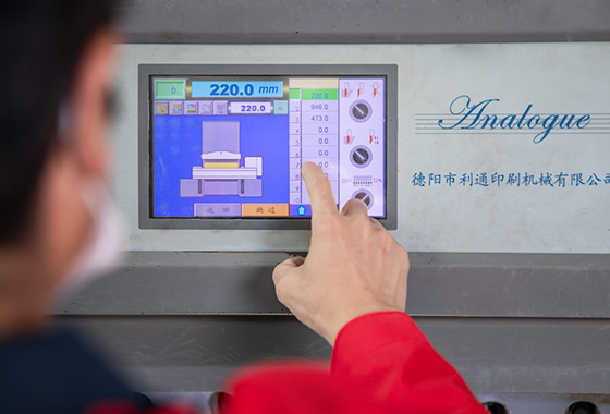 a-worker-putting-fingers-on-the-machine-control-board