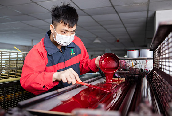 a-worker-pouring-pigment-to-the-machine
